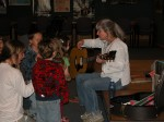 Lisa with guitar and children